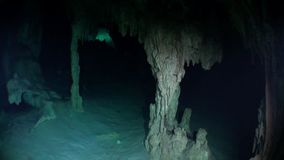Underwater caves in Yucatan. Scuba diving in Mexico. Rocks and stones of cenotes in pure water stock video footage