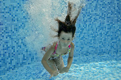 Underwater child jumps to swimming pool Stock Image