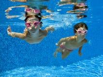 Underwater children. Two girls swimming underwater in the pool Royalty Free Stock Photo