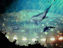 Underwater city. A great lighted city under the ocean, with several marine animals observing it Royalty Free Stock Photography