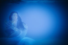 Underwater close up portrait of a woman royalty free stock photography