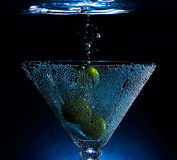 Underwater cocktail. With olives and splashes Royalty Free Stock Image
