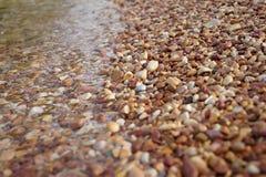 Underwater color stone Pebble Beach.Stone underwater rocky beach Royalty Free Stock Photography