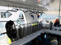 Underwater diving equipment. Many diving cylinders. Boat to sail stock images