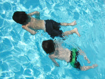 Underwater explorers. Two boys exploring under water together Royalty Free Stock Photo