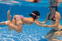 Underwater family in swimming pool Stock Images