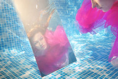 Underwater fashion portrait. With mirror Royalty Free Stock Photography