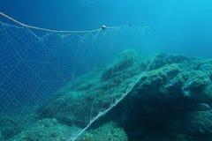 Underwater fishing net gillnet Mediterranean sea. Underwater rocky seabed with a fishing net gillnet in the Mediterranean sea, Cap de Creus, Cadaques, Catalonia stock images