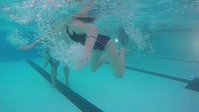 Underwater fun. Children have fun, filmed from underwater stock video footage