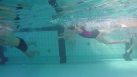 Underwater fun. Children have fun, filmed from underwater stock video