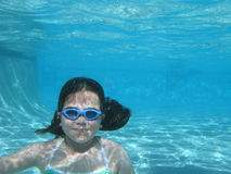 Underwater Girl. A young girl underwater in a swimming pool Royalty Free Stock Images