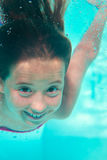 Underwater girl in the pool Stock Photography