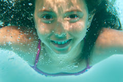 Underwater girl in the pool Royalty Free Stock Photography