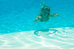 Underwater girl in the pool Stock Photos