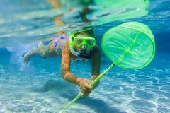 Underwater girl snorkeling Stock Images