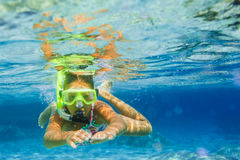 Underwater girl snorkeling stock photo