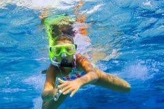 Underwater girl snorkeling Royalty Free Stock Image