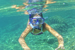 Underwater girl snorkeling Royalty Free Stock Images