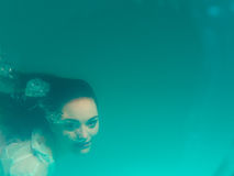 Underwater girl in swimming pool Stock Photos