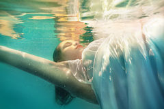 Underwater girl in swimming pool Stock Image