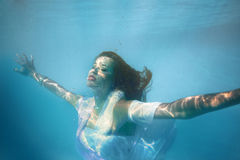 Underwater girl in swimming pool Royalty Free Stock Photo