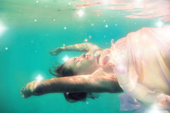Underwater girl in swimming pool Royalty Free Stock Photography