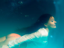 Underwater girl wearing bikini in swimming pool Royalty Free Stock Photography