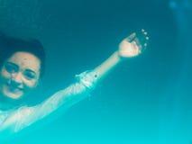 Underwater girl wearing bikini in swimming pool Royalty Free Stock Photos