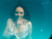 Underwater girl wearing bikini in swimming pool Royalty Free Stock Images