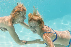 Underwater girls in thepool Stock Images