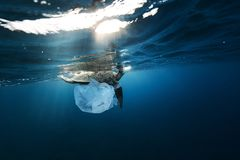 Underwater global problem with plastic rubbish stock photos