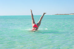 Underwater handstand young woman beach Stock Photography
