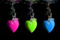 Underwater heart splash Stock Images