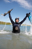 Underwater hunter. In full equipment out of the water rejoicing emotional victory Royalty Free Stock Photo