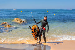 Underwater hunter in flippers preparing to dive. Underwater fishing in Atlantic Ocean. Royalty Free Stock Images