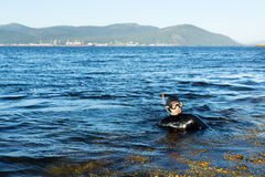 Underwater hunter in a wetsuit in water Stock Photo