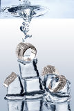 Underwater Jewelery. A view of jewelery being dropped on ice cubes underwater Royalty Free Stock Photos