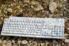 Underwater Keyboard. A computer keyboard underwater with bubbles coming up stock images