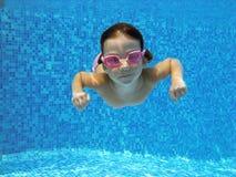 Underwater kid. Child swimming underwater in the pool Stock Photo