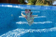 Underwater kid in swimming pool Royalty Free Stock Photo