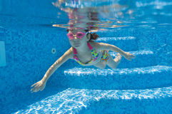 Underwater kid in swimming pool Stock Photos