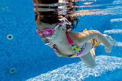 Underwater kid in swimming pool Stock Photo
