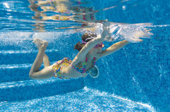 Underwater kid in swimming pool royalty free stock photos