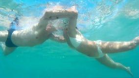 Underwater kiss stock video footage