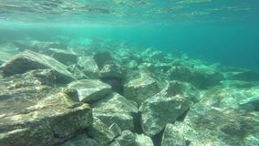 Underwater landscape with rocks stock footage