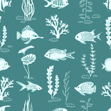 Underwater life vector background in blue color. Silhouettes of corals, seaweeds and fish seamless pattern Royalty Free Stock Photo