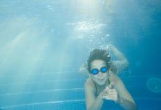 Underwater little girl Stock Images