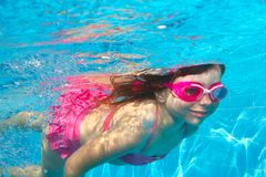 Underwater little girl pink bikini Royalty Free Stock Image