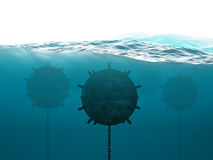 Underwater minefield concept. Old anchor contact mines under water Royalty Free Stock Photography