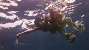 Underwater model free diver swims in clean transparent blue water in Red Sea. stock video footage